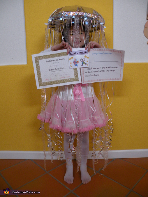 The 2 awards she gets from her class teacher and the school Students Council for Most Unusual Costume, Homemade Jellyfish Costume