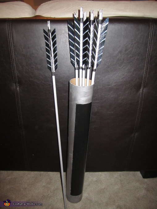 The arrows are real, custom commissioned online. The quiver is a poster mailer tube that I cut and painted to look like her quiver in the movie. Very easy!, Katniss Everdeen Costume