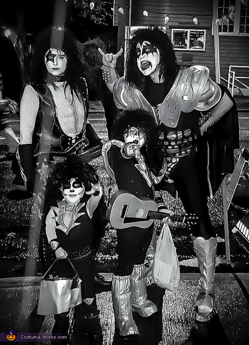 A photo a friend took of us out trick-or-treating, KISS Costume