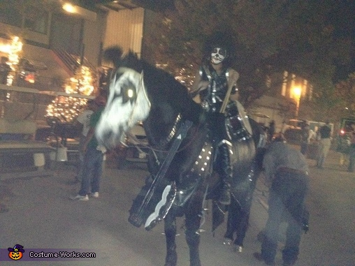 Not a great picture but it shows the homemade battle axe guitar, Kiss Horse Costume