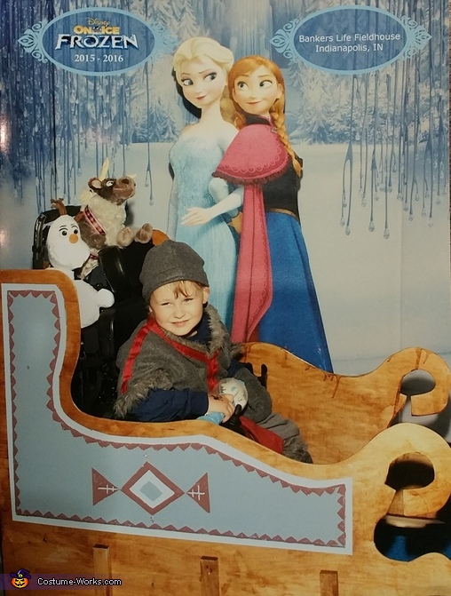 Gus in front of backdrop at Frozen on Ice, Kristoff with Sleigh Costume