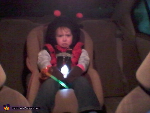 pouting because she didn't want to leave her friend, Ladybug Baby Costume
