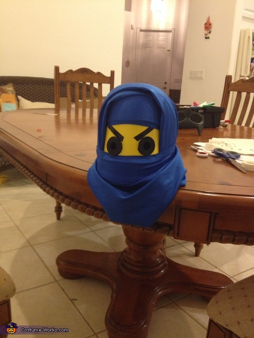 Attaching the fabric to helmet and putting on eye plate, Lego Ninjago Jay Costume