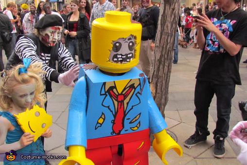 Zombie sister eating removable Lego minifigure face., Lego Zombie Minifigure Costume