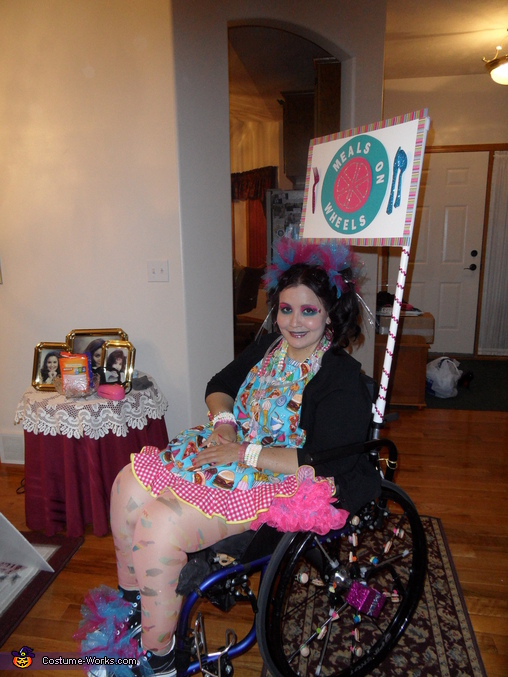 Food inspired outfit -- apron, food leggings, candy necklaces and bracelets, and ring pops., Meals on Wheels Wheelchair Costume