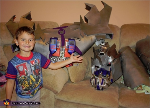 My son showing off the costumes...OFF, Megatron Transformers Prime Costume