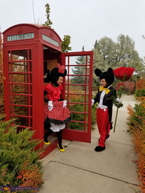 Minnie finishing a telephone call with Donald Duck, Mickey and Minnie Costume