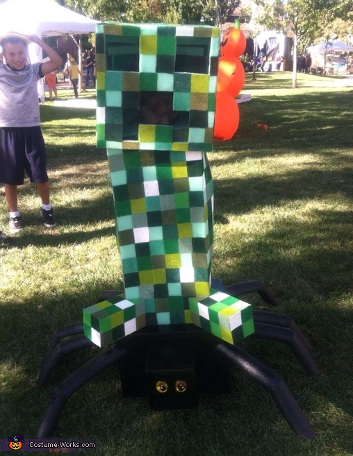 At the Halloween fair, Minecraft Boys Costume Creeper riding a Spider