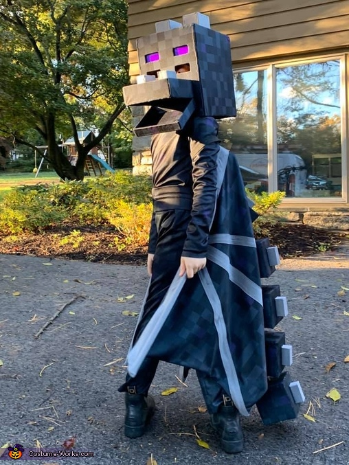 Turning to look behind him, Minecraft Ender Dragon Costume