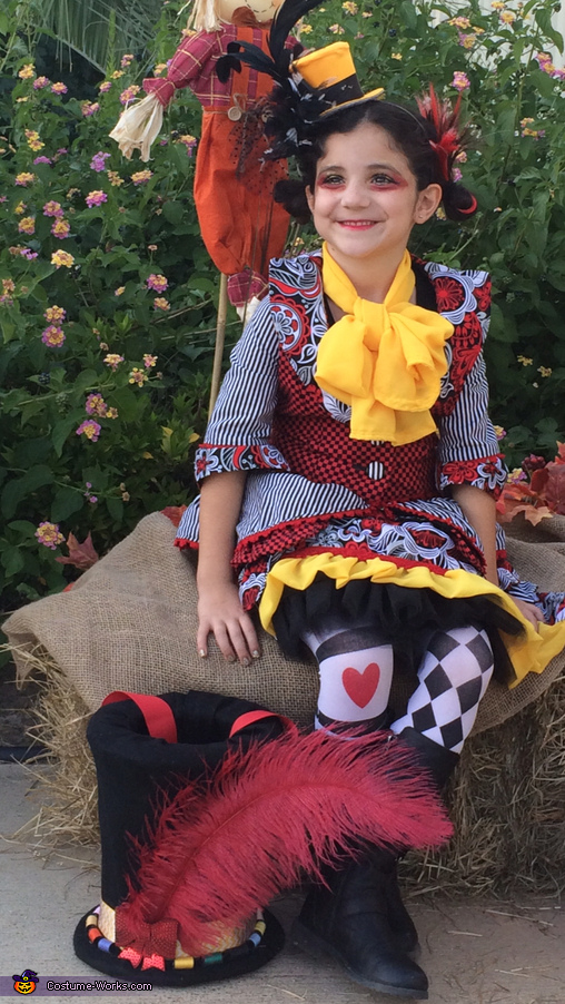 MIss Mad Hatter: sitting with treatbag hat, Miss Mad Hatter Costume