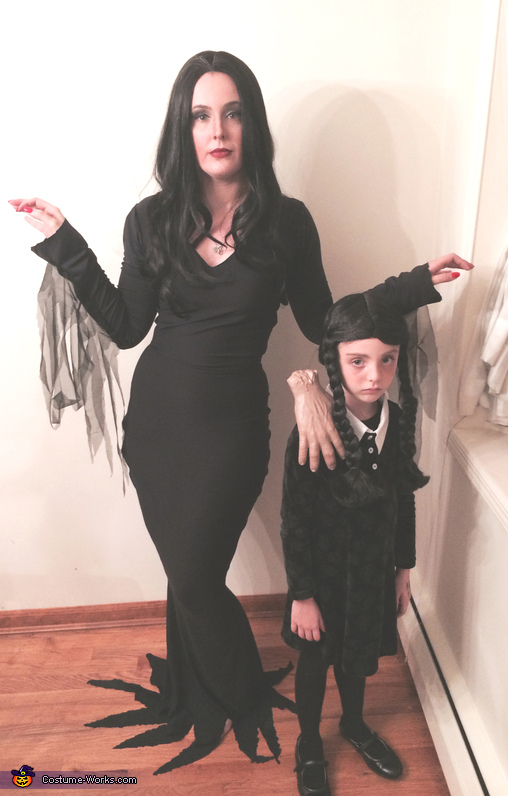 Morticia and Wednesday Addams with Thing Costume