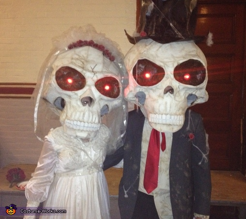 At a Halloween party, Mr. and Mrs. Bobble Costumes