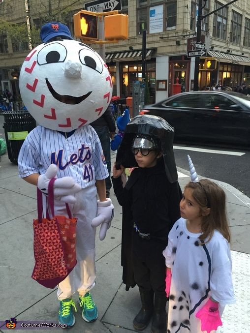Mr. Met taking pictures with friends., Mr. Met Costume