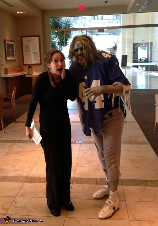 Giants zombie with a coworker in the bank lobby, NY Giants Zombie Costume
