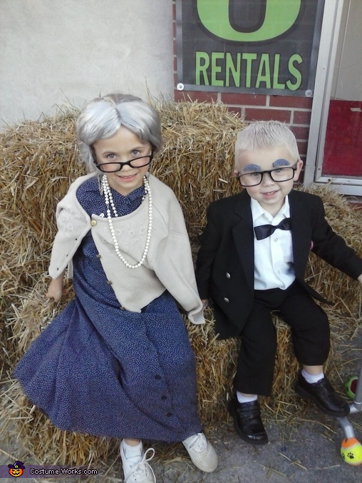 both kids sitting to have there pic taking together looks like a great old couple to me , Old Lady and Carl from Up Costume