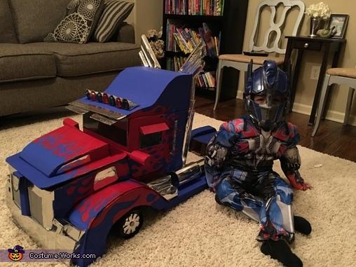 Sitting beside Optimus, Optimus Prime Transforming Costume
