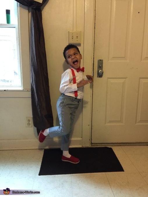 One his favorite poses to do while taking a picture, Pee Wee Herman Costume