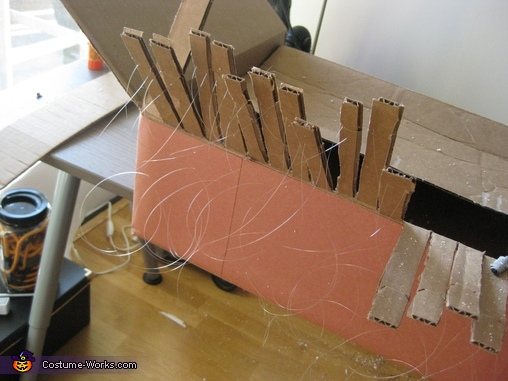 Threading clear wire around/through the cardboard under each white key, Player piano with 18th century bust Costume