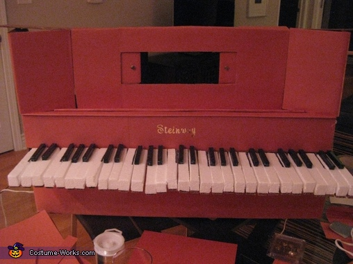 Covering box in construction paper and added letters, Player piano with 18th century bust Costume