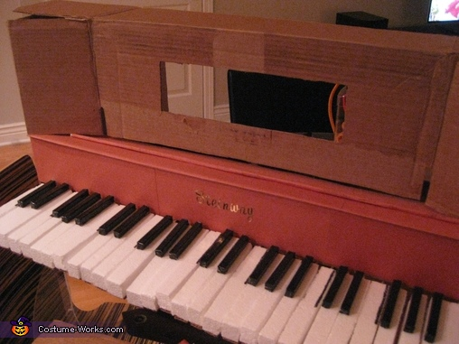 Added more cardboard box for front and sides of piano, Player piano with 18th century bust Costume