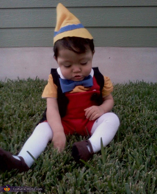Trying to get his shoes off , Pinocchio Costume