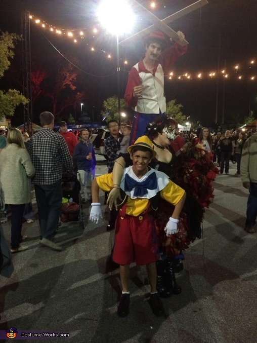 Performers stopped to get a picture with a fellow puppet., Pinocchio Costume