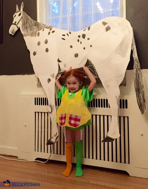 Strong Pippi lifting her horse Old Man, Pippi Longstocking Costume