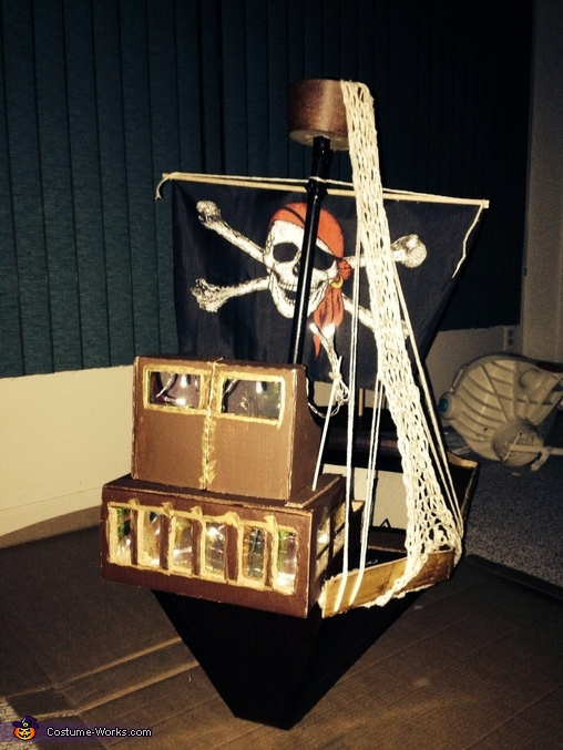 Back view of the ship. The cabin lights up and also serves as a flashlight, Pirate and his Ship Costume
