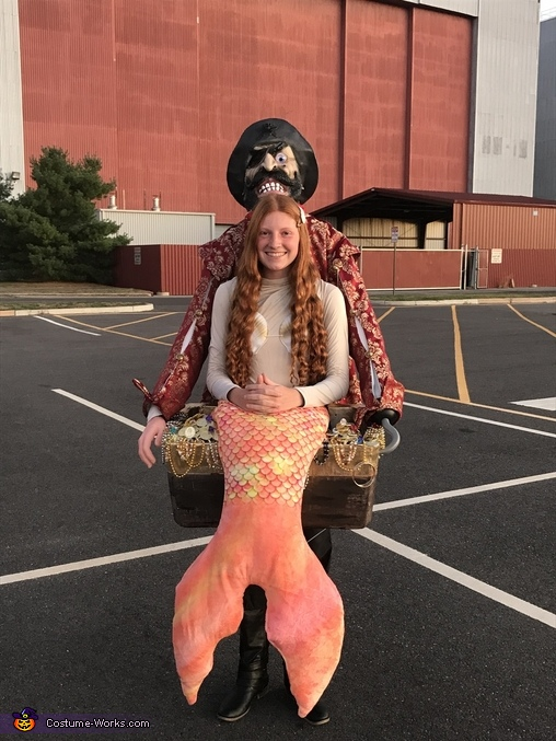 Pirate carrying a Mermaid Costume
