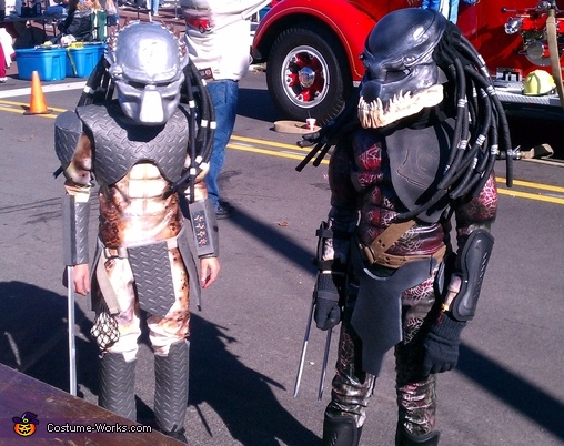 Boys wearing costumes at a local festival., Predators Costume