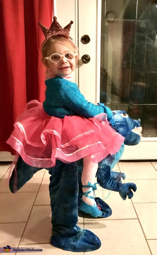 Princess riding a Dinosaur Costume