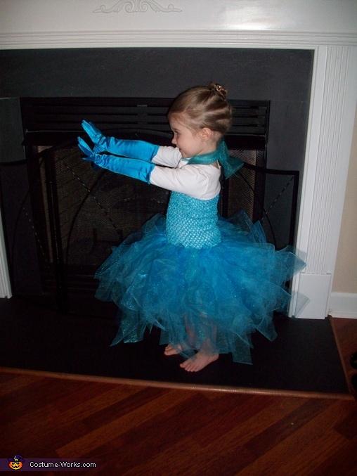 using her 'freezing' powers :), Queen Elsa Costume