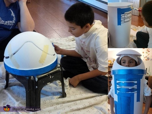 Xavier paints the rim and the stencils, R2D2 DIY Costume