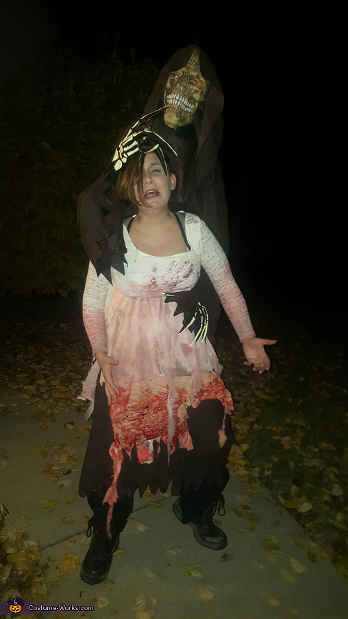 full view of picture, Reaper and his Mangled Victim Costume