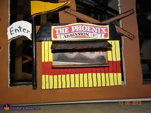 The ticket booth with the model of the Phoenix Roller Coaster, Riding a Roller Coaster Costume