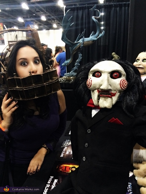 With the iconic Billy the Puppet from 'SAW', SAW Reverse Bear Trap Costume