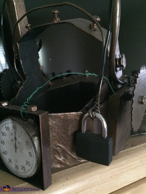 Back view of the trap shows the timer and lock., SAW Reverse Bear Trap Costume