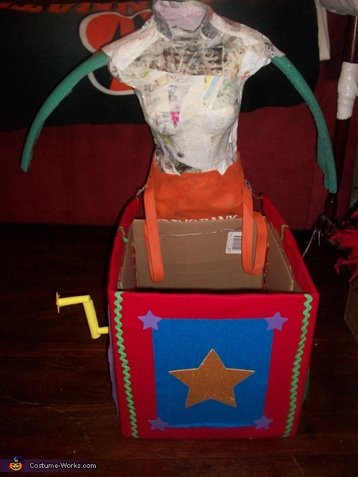 Attached mannequin to box., Scary Clown Carrying Jester Illusion Costume