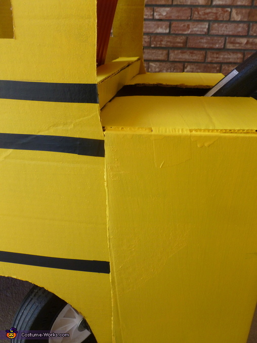 Close up of the hood attached to the sides from the outside., School Bus Costume