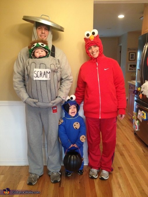Bundled up to go trick-or-treating, Sesame Street Gang Family Costume