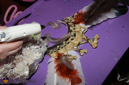Gluing Feathers on the Witch Doctor's Crown, Spooky Witch Doctor and Shrunken Head Illusion Costumes