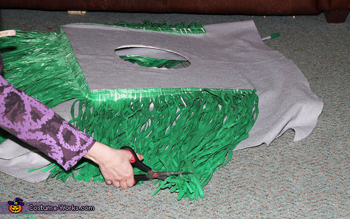 Attaching Grass Tableskirt to Table, Spooky Witch Doctor and Shrunken Head Illusion Costumes