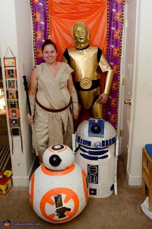 Family shot with droids ducked inside., Star Wars Family Costume