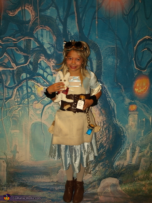 Alice with her 'Drink Me' bottles and homemade White Rabbit, Steampunk Wonderland Family Costume