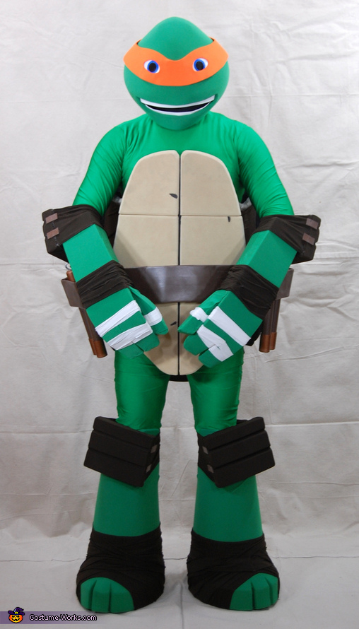Arms in for a view of the hand and elbow pad details, Teenage Mutant Ninja Turtle Michelangelo Costume