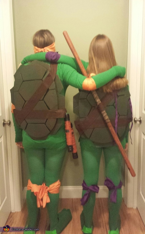 The shells, belts, sashes, bands, masks, and nunchucks were homemade., Donatello and Michelangelo Costume