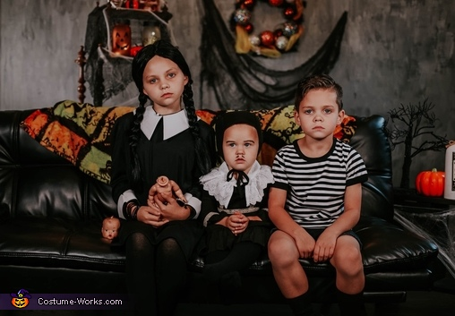 This is an image of Wednesday, Pugsley, and Pubert., The Addams Family Costume