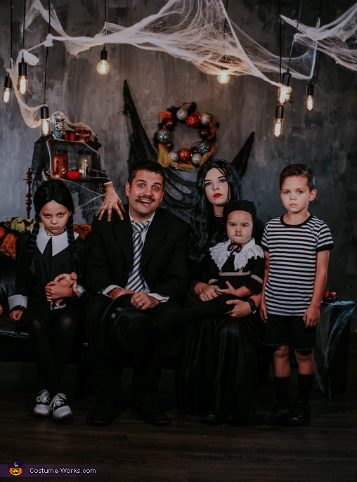 This is a family shot of the entire family with some Photoshop rendering to add Thing, The Addams Family Costume