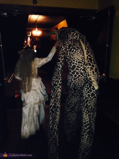 Getting guided thru door, The Giraffe Costume