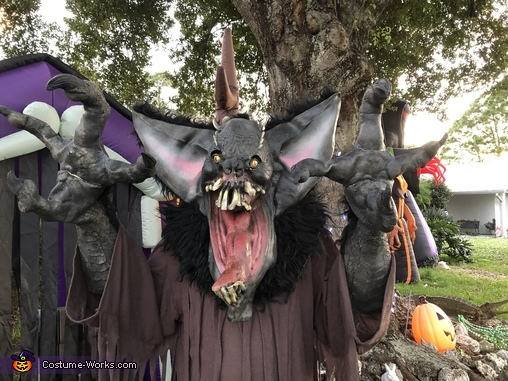 Gruesome Bat by his haunted house close up., The Gruesome Bat Costume